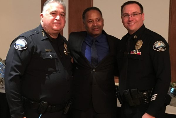(Left to right) Retired Signal Hill Chief of Police Michael Langston, co-founder of AUHS Pastor Gregory Johnson, and new Signal Hill Chief of Police Chris Nunley at Langston's retirement party at the Petroleum Club on December 10th, 2016.