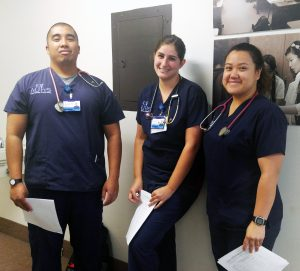 AUHS nursing students Ryan Albano, Brittany Harwick, and Kristine Barlis waiting for their turn in Boot Camp on Tuesday, March, 28, 2017.
